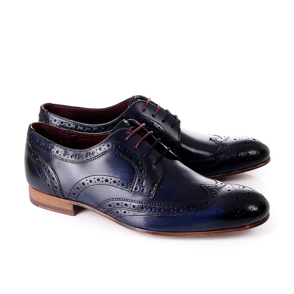 f18deb344f52 Ted Baker Gryene Navy Lace-Up Wingtip Oxfords. M 5aedda5136b9decaa239d4b6.  Other Shoes ...